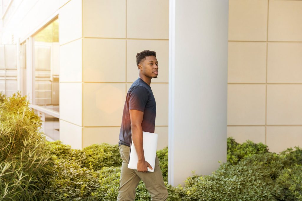 student walks to bank to withdraw money in Nigeria