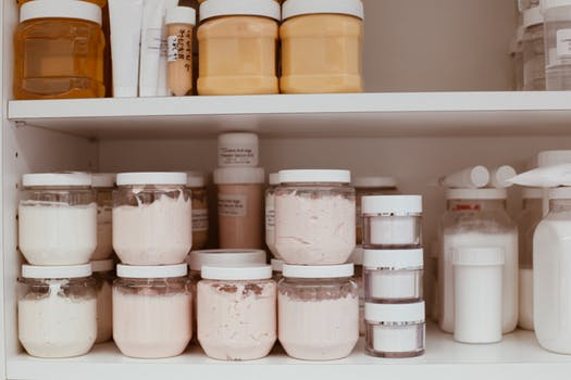 Bottles of body cream in a shelve