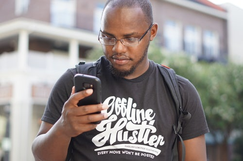 a Nigerian using phone for small business