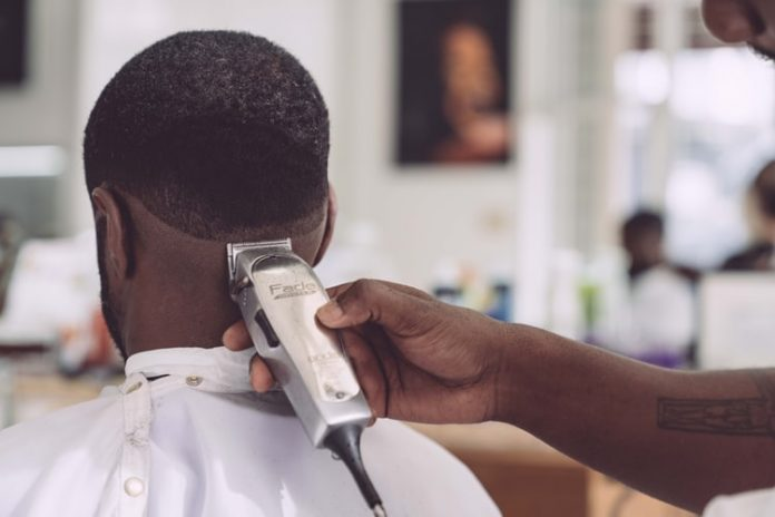 student barbing hair