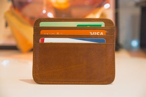 atm cards in a brown purse