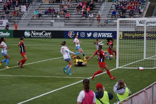 female footballers scoring a goal