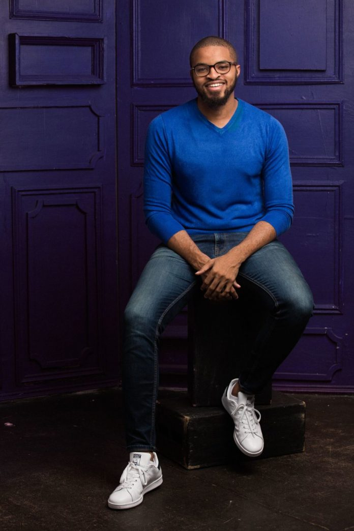 Young man wearing blue top and jeans