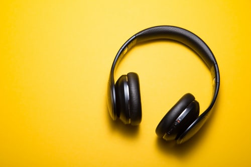 black head phone on a yellow background