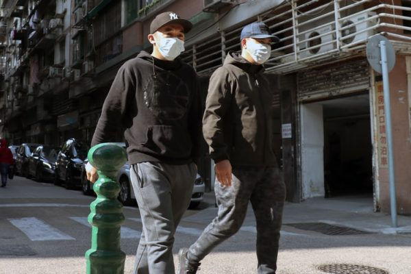 Two men using face masks