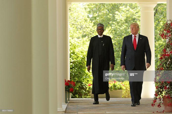 Buhari standing next to Trump