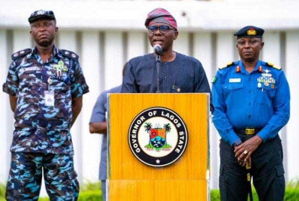 Governor Sanwo-Olu and aide
