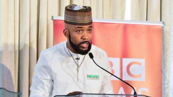 BANKY W SPEAKING AT A EVENT