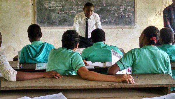 Teenager teaching school mates