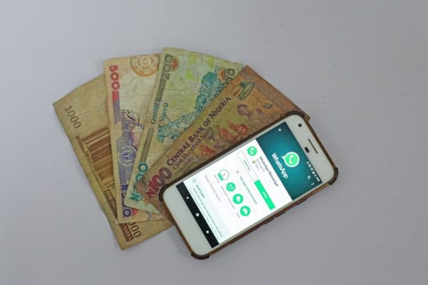Nigerian currency and a phone