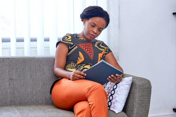 Lady reads business registration document