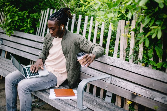 YOUNG AFRICAN GUY ON HIS LAPTOP