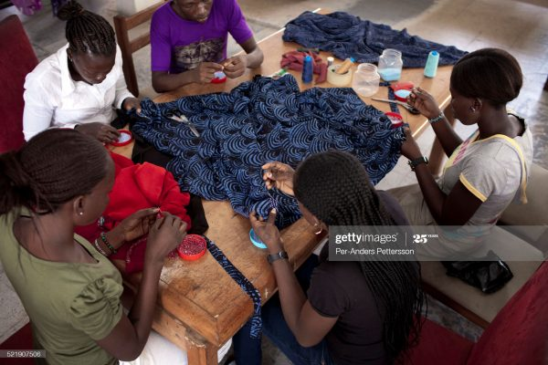 Students sew in a fashion school in Nigeria