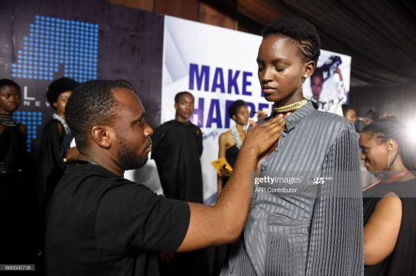 Fashion designer in Nigeria taking client measurement