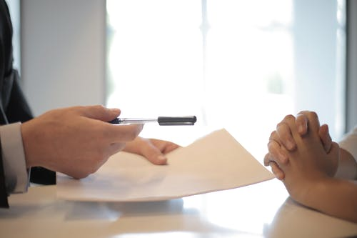 lawyer signs documents of company registration