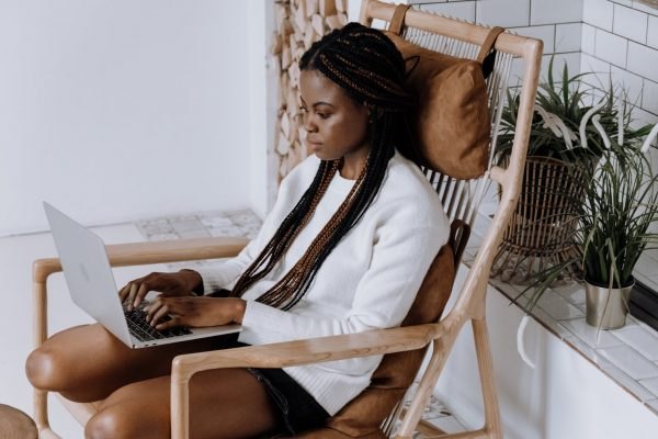 Nigerian types on her laptop