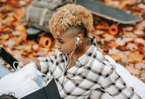 Lady listening to new podcasts in Nigeria