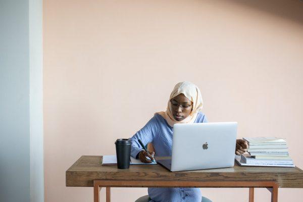 girl at home making money online