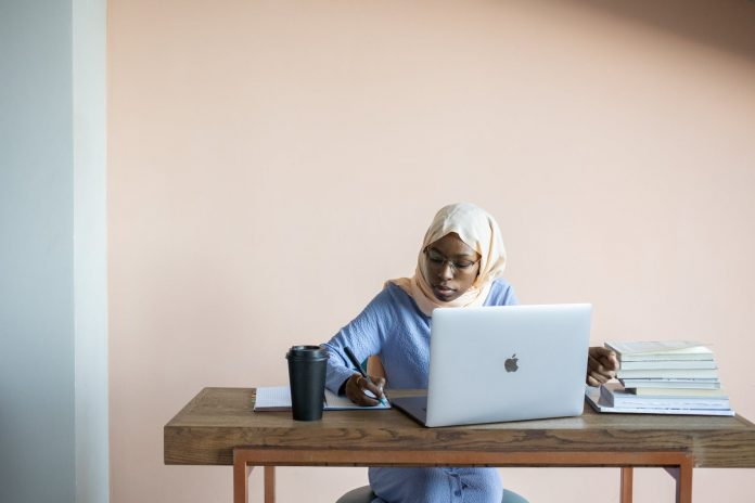 Lady in best online university for Nigerian students