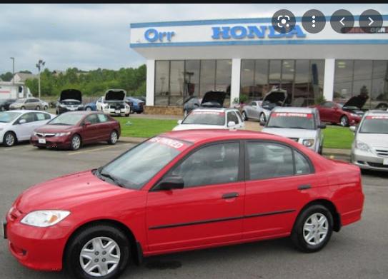 Nigerian student drives red Honda Civic car