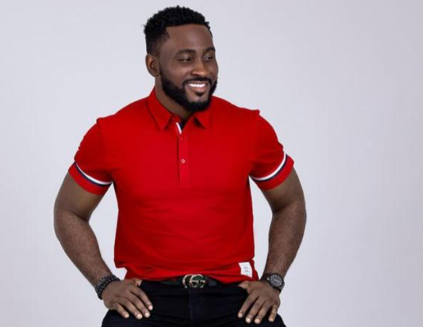 pere bbnaija in red t-shirt and black Jeans